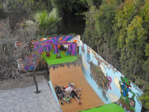 Final images of art on the walls and skate ramp.  Time to take a break! After the graffiti art was finished, a final clear coat of Skatepaint was applied on the wooden ramp to seal in the maseterpiece!