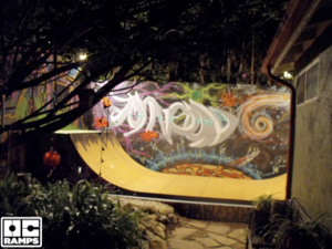 Night time view of the finalized ramp with graffiti art and coated Skatepaint.