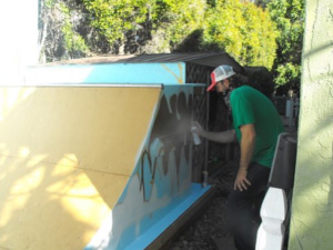 Spray painting the sides of the ramps.